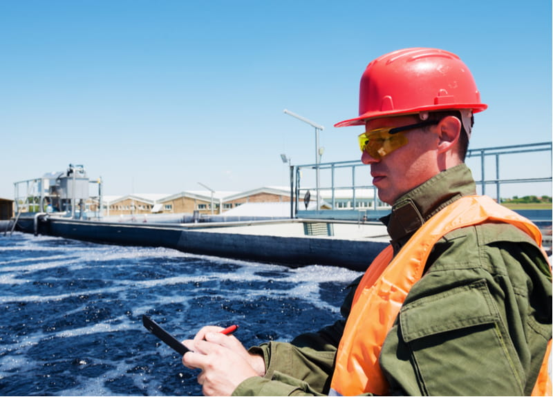An engineer controlling a quality of water